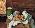 Vessels Fruit And Cloth In Front Of A Chest - Paul Cezanne