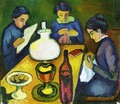 Three Women at the Table by the Lamp - August Macke
