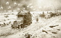 British Transport train making its way under heavy shell fire along the snow-bound Ypres roads - (after) Villiers, Frederic