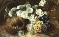 A Still Life of Flowers and a Bird's Nest on a Mossy Bank - Vincent Clare