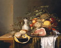 Still life with a basket of fruit and a ham - Laurens Craen