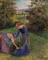 Women Gathering Grass - Camille Pissarro