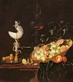 A Still Life of fruit with a nautilus cup on a draped ledge - Georg Hinz