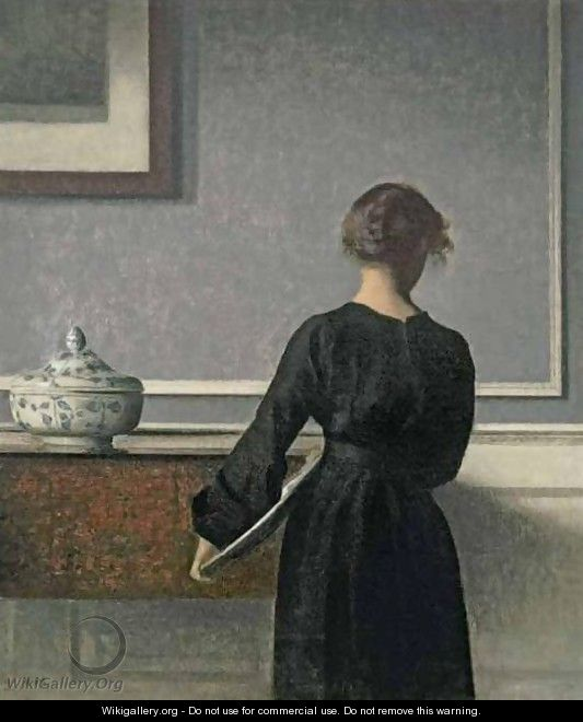Young Woman from Behind - Vilhelm Hammershoi