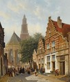 Elegant figures in a sunlit Dutch town - Adrianus Eversen