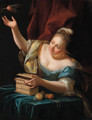 A woman, seated by a table in fancy costume, freeing a songbird from its cage - Godfried Schalcken