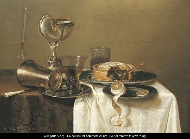 An overturned silver tumbler and a roemer on a pewter plate, a facon-de-Venise wineglass, a nautilus cup, a pie and a partly-peeled lemon - Gerrit Willemsz. Heda
