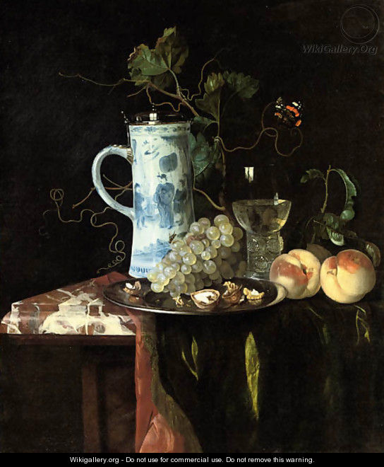 A Chinese transitional blue and white silver-mounted tankard, grapes and walnuts on a silver plate, a