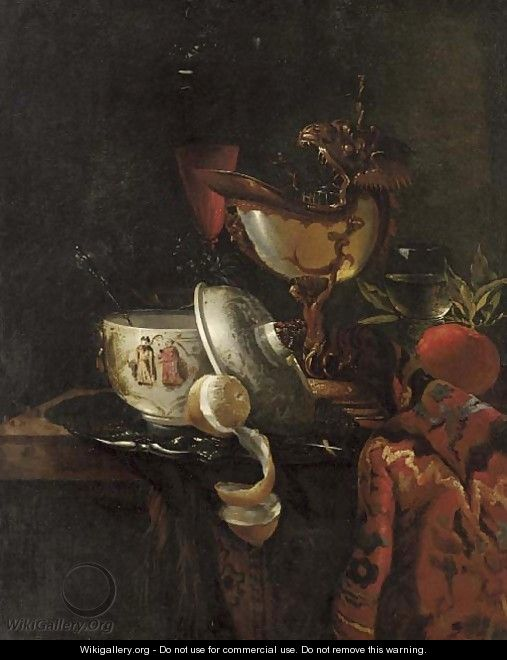 A nautilus cup, an oriental bowl on a silver tray and glasses of wine on a table - (after) Willem Kalf