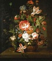 Tulips, roses, morning glory, an iris and other flowers in an urn on a stone ledge - (after) Rachel Ruysch