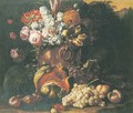 A still life of flowers in a bronze vase, with a melon, grapes, peaches and other fruit on a forest floor - Gaspar-pieter The Younger Verbruggen