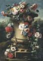 Narcissi, tulips, chrysanthemums, roses and other flowers in a stone urn with hollyhocks, a wooded landscape beyond - Gasparo Lopez