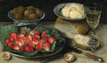 Strawberries on a Plate, Walnuts in a porcelain Bowl, Butter on a Plate, a Loaf of Bread, a faon de venise Wine Glass, a Knife and a Fork on a Table - Georg Flegel