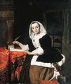 An elegant lady writing at her desk, with a dog beside her - Gabriel Metsu