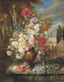 Roses, lillies, tulips, poppies and other flowers in a vase in a classical garden - John Wainwright