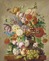 Assorted summer flowers in a vase on a stone ledge - Josef Nigg