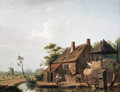 A farmstead by a canal - Isaak Ouwater