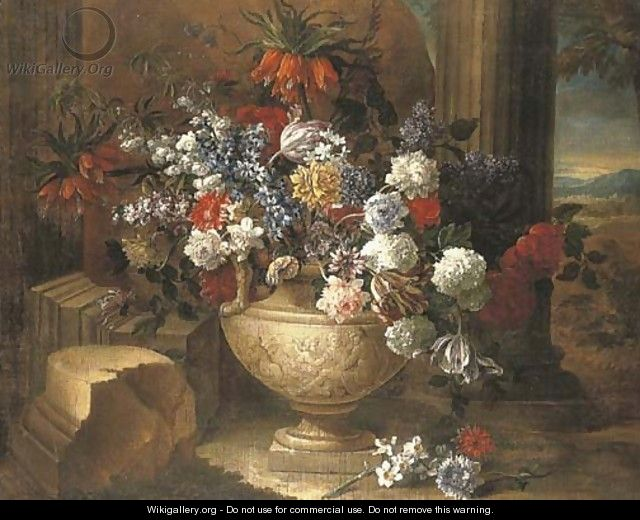 Tulips, lilacs, dahlias and other flowers in a sculpted vase, before a column, a landscape beyond - Jean-Baptiste Monnoyer