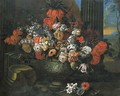 Tulips, roses, carnations and other flowers in a sculpted vase before a column, a landscape beyond - Jan-baptist Bosschaert