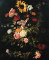 A sunflower, roses, parrot tulips, a carnation and other flowers in a glass vase on a partly draped marble table - Jan Weenix