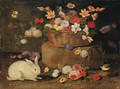 Roses, dahlias, paeonies, tulips and other flowers in a basket on a stone seat, with a white rabbit, a great tit and a butterfly - Jan van Kessel
