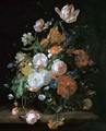 Roses, tulips and other flowers in a glass vase on a stone ledge - Rachel Ruysch
