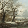 A winterlandscape with a traveller on a path - Pieter Lodewijk Francisco Kluyver