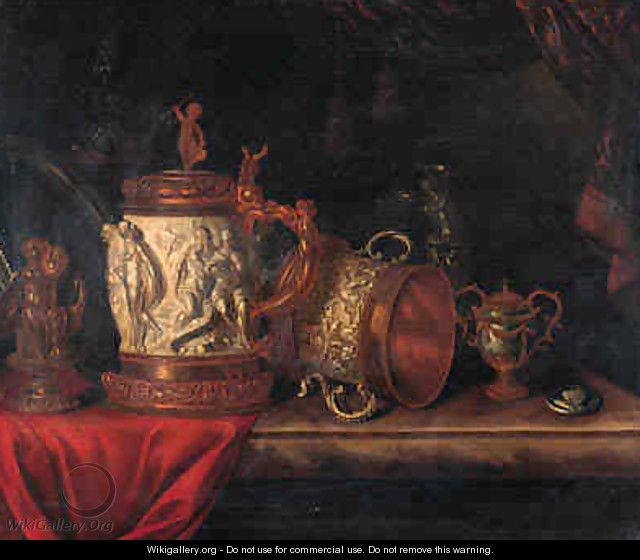 A pronk still life with a gilt dish, a gilt cup and cover, a bronze sculpture of a seated putto, an ormulo mounted carved ivory tankard - Pieter Gerritsz. van Roestraeten