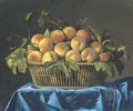 Peaches in a wicker basket on a draped table - Pierre Dupuis