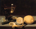 A lemon, a partly peeled lemon, grapes, a roemer and knife on a stone ledge - Pieter Claesz.
