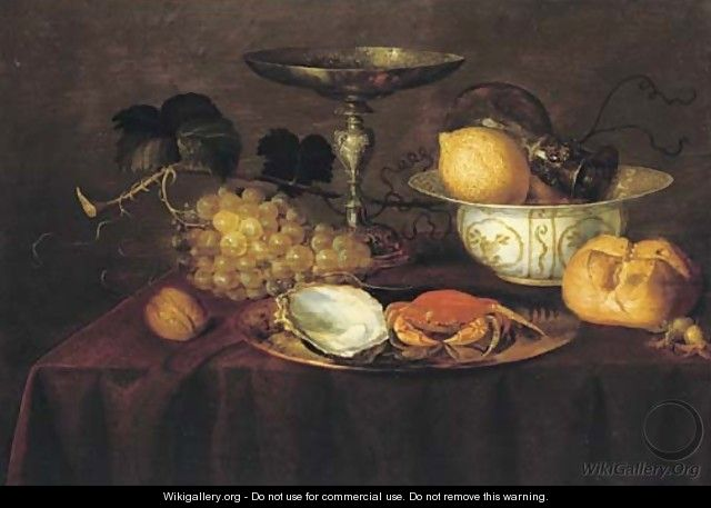 A silver dish with an oyster and a crab, a walnut, white grapes, a silver