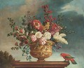 Summer flowers in a vase on a plinth, with a parrot and butterfly to the side; and Another similar - Jean-Baptiste Monnoyer