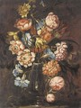 Carnations, tulips, daffodils, roses and other flowers in a glass vase on a ledge - (after) Juan De Arellano