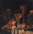 A roemer, a silver-gilt cup, oysters and a peeled lemon on a pewter plate, a knife, a casket with apples and grapes on a partially draped table - Abraham Hendrickz Van Beyeren
