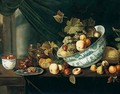 Still Life With Fruit Tumbling From A Porcelain Bowl, On A Wooden Table - Michiel Simons