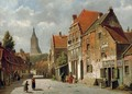 A sunlit street in a Dutch town - Willem Koekkoek
