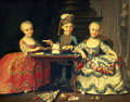 A boy and two girls building a house of cards with other games by the table - Francois-Hubert Drouais