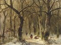 Woodgatherers on a forest path in winter - Andreas Schelfhout