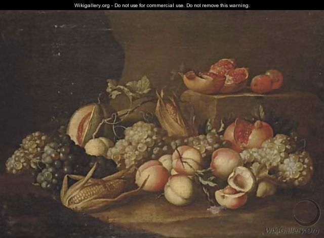 Peaches, grapes, corn on the cob, pomegranates and a melon on a stone floor - Alexander Coosemans