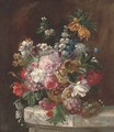 Roses, tulips, chrysanthemums, narcissae and other summers blooms in an urn by a bird's nest on a marble ledge - (after) Franz Xaver Petter
