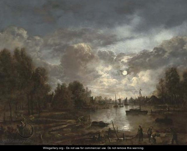 A moonlit river landscape with figures and shipping, a town beyond - (after) Aert Van Der Neer