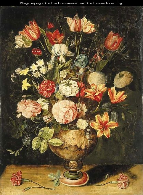 Tulips, irises, roses, carnations, lilies, narcissi and other flowers in a sculpted urn on a table - Andries Daniels or Danielsz