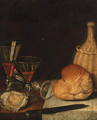 Wine glasses, an oyster, a loaf of bread, a wine bottle and a knife on a partially draped table - (after) Gotthardt Von Wedig