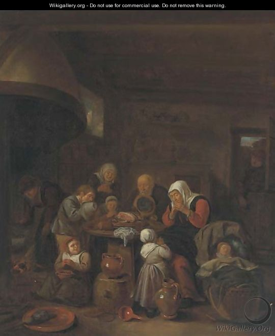 A kitchen interior with a peasant family praying before a meal - (after) Richard Brakenburgh