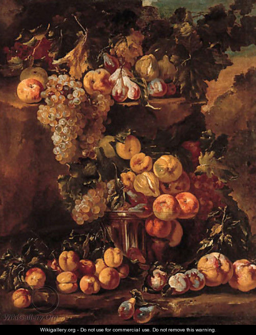 Grapes, apples, plums and figs in a glass bowl with other fruit on a ledge in a landscape - (after) Michele Pace Del (Michelangelo Di) Campidoglio