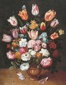 Tulips, daffodils, roses, an iris and other flowers in a pottery vase on a ledge - (after) Osias, The Younger Beert