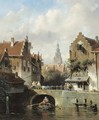 View of a canal in a Dutch town - Charles Henri Leickert
