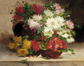Chrysanthemums and Geraniums in a basket on a ledge - Eugene Henri Cauchois