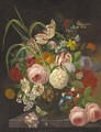 Peonies, tulips and other summer flowers in a glass vase on a stone ledge - F. van Geit
