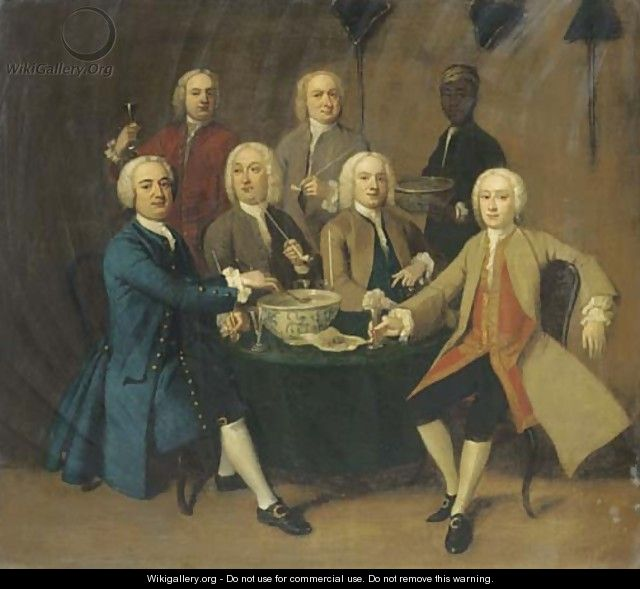 Gentlemen drinking and smoking pipes round a table in an interior, a servant bearing a bowl of punch - English School